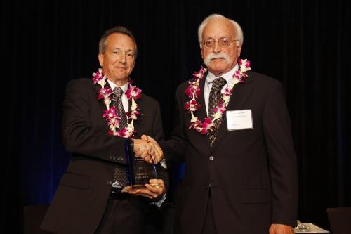 Robert Byrne, Ph.D. receives STEM Innovation & Research Award from Larry Langebrake of SRI (right).